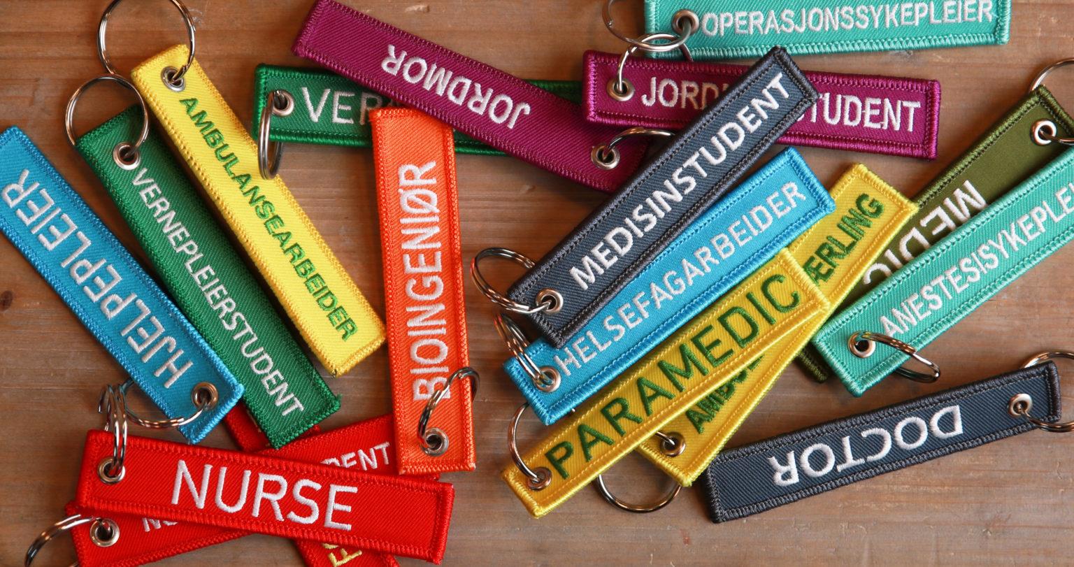 Bilde av flere nøkkelringer for helsepersonell og studenter, fra Cingulum AS